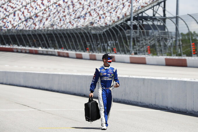 Driver John Hunter Nemechek walks to his car before the start of the NASCAR Cup Series auto race Sunday, May 17, 2020, in Darlington, S.C. (AP Photo/Brynn Anderson)