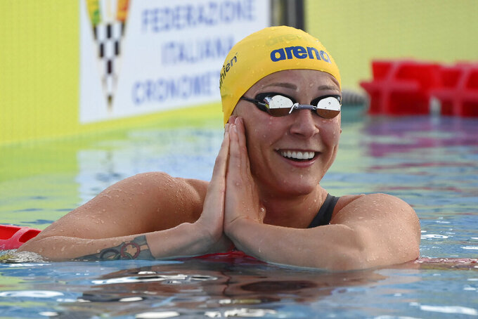 Sweden's Sarah Sjoestroem reacts after a race at the 58th edition Settecolli international swimming hills event in Rome, Friday June 25, 2021.  (Alfredo Falcone/LaPresse via AP)