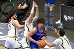 Colorado State guard David Roddy (21), Adam Thistlewood, second from left, and John Tonje (1) defend beneath the basket as Louisiana Tech forward Kenneth Lofton Jr. (2) positions for a shot opportunity in the second half of an NCAA college basketball game in the NIT, Sunday, March 28, 2021, in Frisco, Texas. (AP Photo/Tony Gutierrez)