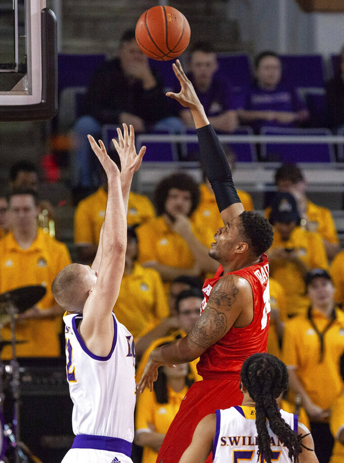 Houston's Breaon Brady, right, attempts a shot over East Carolina's Dimitrije Spasojevic, left, during the first half of an NCAA college basketball game in Greenville, N.C., Wednesday, Feb. 27, 2019. (AP Photo/Ben McKeown)