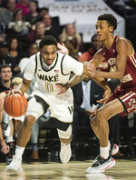 Wake Forest guard Brandon Childress (0) dribbles around Boston College forward Kamari Williams (14) in the first half of an ACC mens college basketball game on Sunday, Jan. 19, 2020, at Joel Coliseum in Winston-Salem, N.C. (Allison Lee Isley/Winston-Salem Journal via AP)