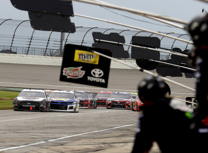 Drivers down pit road during a pit stop during a NASCAR Cup Series auto race at Chicagoland Speedway in Joliet, Ill., Sunday, June 30, 2019. (AP Photo/Nam Y. Huh)