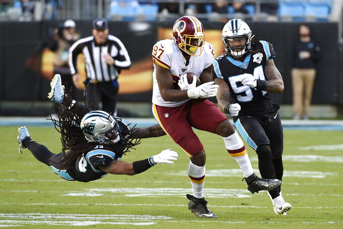Carolina Panthers free safety Tre Boston dives for Washington Redskins tight end Jeremy Sprinkle (87) during the second half of an NFL football game in Charlotte, N.C., Sunday, Dec. 1, 2019. (AP Photo/Mike McCarn)