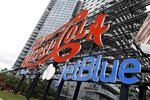 An LED lighted JetBlue logo has been added to the landmarked, neon-lit Pepsi-Cola sign in the Long Island City neighborhood of the Queens borough of New York, Wednesday, Aug. 21, 2019. The JetBlue name will remain until Oct. 1, part of a promotion to announce a partnership in which the airline will serve PepsiCo drinks. (AP Photo/Richard Drew)