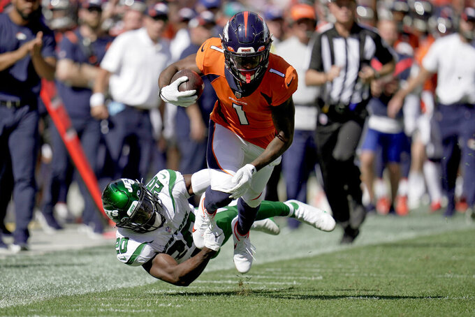 Denver Broncos wide receiver K.J. Hamler (1) is tackled by New York Jets free safety Marcus Maye (20) during the first half of an NFL football game, Sunday, Sept. 26, 2021, in Denver. (AP Photo/Jack Dempsey)