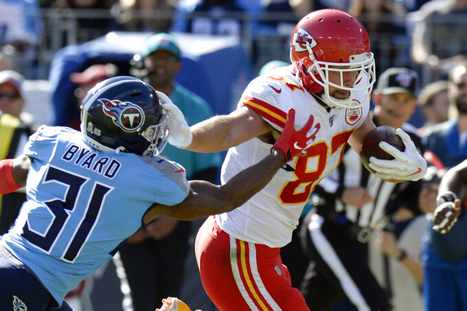 Kansas City Chiefs tight end Travis Kelce (87) carries the ball as he is defended by Tennessee Titans free safety Kevin Byard (31) in the first half of an NFL football game Sunday, Nov. 10, 2019, in Nashville, Tenn. (AP Photo/Mark Zaleski)