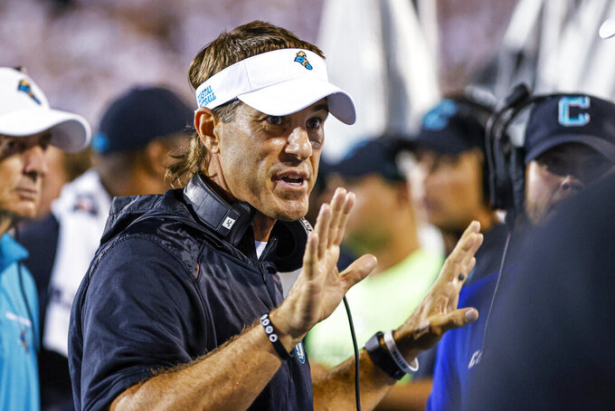 Coastal Carolina coach Jamey Chadwell talks to his team during the first half of an NCAA college football game against Kansas in Conway, S.C., Friday, Sept. 10, 2021. (AP Photo/Nell Redmond)