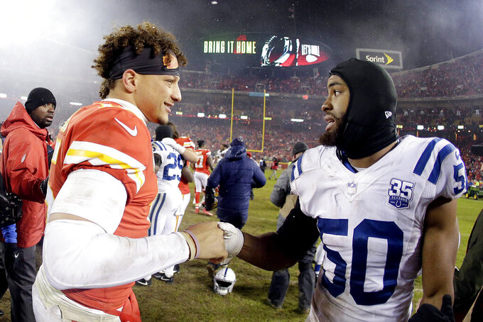 Kansas City Chiefs quarterback Patrick Mahomes (15) greets Indianapolis Colts middle linebacker Anthony Walker (50) after their NFL divisional football playoff game Saturday, Jan. 12, 2019, in Kansas City, Mo. The Chiefs won 31-13. (AP Photo/Charlie Riedel)