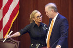 Sen. Lauren Book, D-Plantation, left, confers with senate president Wilton Simpson, R-Trilby, during a special session, Tuesday, May 18, 2021, in Tallahassee, Fla. (AP Photo/Steve Cannon)