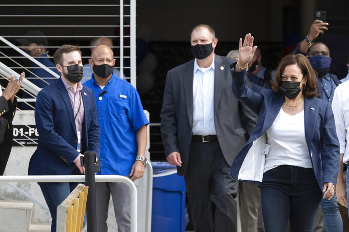Vice President Kamala Harris waves as she walks on to the field before an NCAA college football game between Howard and Hampton at Audi Field in Washington, Saturday, Sept. 18, 2021. Harris attended Howard University and graduated in 1986. (AP Photo/Cliff Owen)