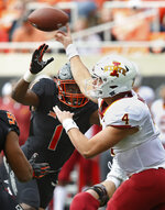 Iowa State quarterback Zeb Noland (4) throws under pressure from Oklahoma State linebacker Calvin Bundage (1) in the first half of an NCAA college football game in Stillwater, Okla., Saturday, Oct. 6, 2018. (AP Photo/Sue Ogrocki)