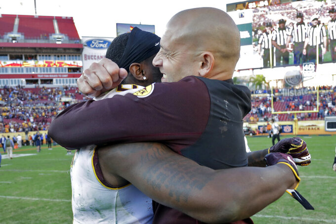 Minnesota head coach P.J. Fleck, right, hugs wide receiver Tyler Johnson after Minnesota defeated Auburn during the Outback Bowl NCAA college football game Wednesday, Jan. 1, 2020, in Tampa, Fla. (AP Photo/Chris O'Meara)
