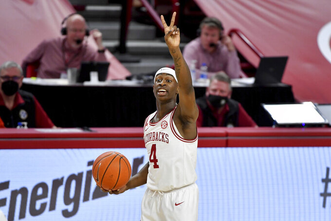 Arkansas guard Davonte Davis (4) runs a play against LSU during the first half of an NCAA college basketball game in Fayetteville, Ark. Saturday, Feb. 27, 2021. (AP Photo/Michael Woods)