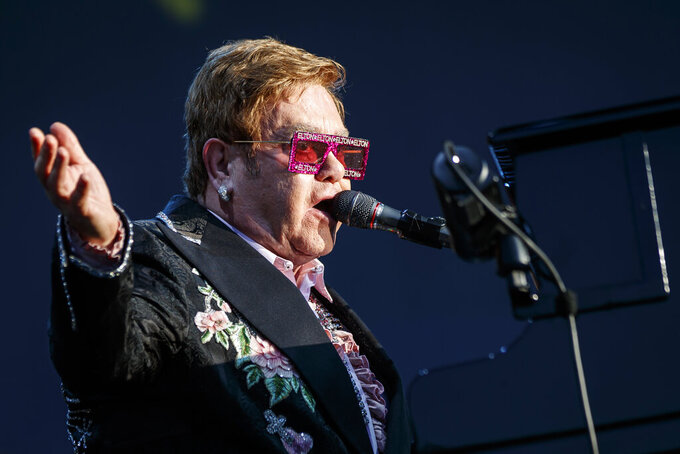 """FILE - British singer Elton John performs during his """"Farewell Yellow Brick Road"""" tour at the 53rd Montreux Jazz Festival (MJF), in Montreux, Switzerland on, June 29, 2019. Due to the global coronavirus pandemic, concert trade publication Pollstar puts the total lost revenue for the live events industry in 2020 at more than $30 billion. With just a few months on the road, Elton John's """"Farewell Yellow Brick Road Tour"""" tops the year's Top 100 Worldwide Tours list with $87.1 million grossed between Nov. 30 through March 7. John's tour ranked No. 2 last year with $212 million grossed. (Valentin Flauraud/Keystone via AP, File)"""