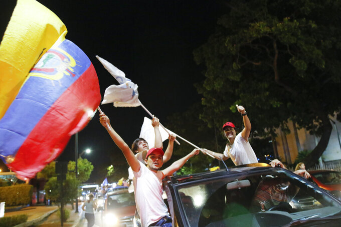 Supporters of Guillermo Lasso, candidate of Creating Opportunities party or CREO, celebrate in Guayaquil, Ecuador, Sunday, April 11, 2021. Lasso, a former banker, won a runoff presidential election beating economist Andres Arauz, an economist protege of former President Rafael Correa.(AP Photo/Angel Dejesus)