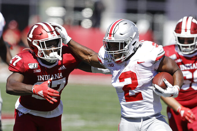 Ohio State running back J.K. Dobbins (2) runs past Indiana defensive back Devon Matthews (27) during the first half of an NCAA college football game, Saturday, Sept. 14, 2019, in Bloomington, Ind. (AP Photo/Darron Cummings)