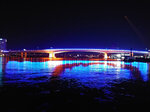 The Acosta Bridge is illuminated with blue lights in downtown Jacksonville, Fla., Tuesday night, June 8, 2021. Florida has doused the rainbow lights temporarily decorating the bridge to celebrate gay rights, saying the decision was not motivated by animus but because the display violated regulations.  The lights were turned back to blue Tuesday night. (Paul Runnestrand/The Florida Times-Union via AP)