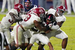 FILE  - Mississippi running back Jerrion Ealy is tackled by Alabama defenders during the second half of an NCAA college football game in Oxford, Miss., in this Saturday, Oct. 10, 2020, file photo. Alabama won 63-48. Alabama is No. 1 in The Associated Press college football poll for the first time this year, Sunday, Nov. 8, 2020, extending its record of consecutive seasons with at least one week on top of the rankings to 13. (AP Photo/Rogelio V. Solis, FIle)