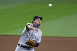 Colorado Rockies third baseman Nolan Arenado makes a throw against the Seattle Mariners in the fifth inning of a baseball game Friday, Aug. 7, 2020, in Seattle. (AP Photo/Elaine Thompson)
