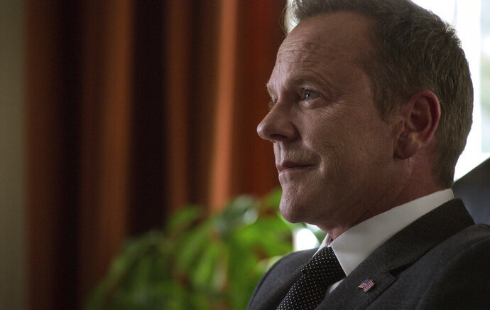 This image released by Netflix shows Kiefer Sutherland as Tom Kirkman in
