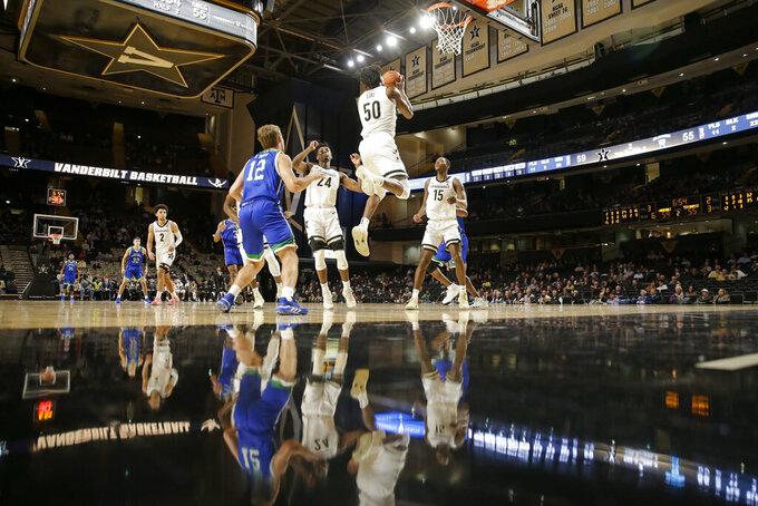 Vanderbilt forward Ejike Obinna (50) grabs a rebound in front of Texas A&M-Corpus Christi guard Peyton Smith (12) in the second half of an NCAA college basketball game Monday, Nov. 11, 2019, in Nashville, Tenn. Vanderbilt won 71-66. (AP Photo/Mark Humphrey)