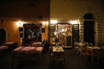 A man sits outside an empty restaurant in Rome's Trastevere neighborhood, Friday, Oct. 23, 2020. In much of Europe, city squares and streets, be they wide, elegant boulevards like in Paris or cobblestoned alleys in Rome, serve as animated evening extensions of drawing rooms and living rooms. As Coronavirus restrictions once again put limitations on how we live and socialize, AP photographers across Europe delivered a snapshot of how Friday evening, the gateway to the weekend, looks and feels. (AP Photo/Alessandra Tarantino)