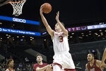 Davidson guard Jon Axel Gudmundsson (3) goes to the basket during the first half of an NCAA college basketball game against the Saint Joseph's in the Atlantic 10 Conference tournament, Friday, March 15, 2019, in New York. (AP Photo/Mary Altaffer)