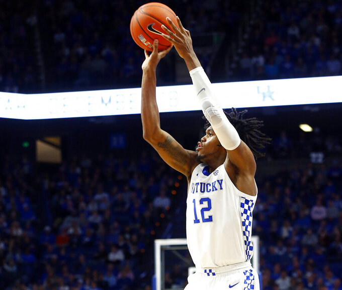 Kentucky's Keion Brooks Jr.takes an uncontested shot during the second half of an NCAA college basketball game against Mount St. Mary in Lexington, Ky., Friday, Nov. 22, 2019. Kentucky won 82-62. (AP Photo/James Crisp)