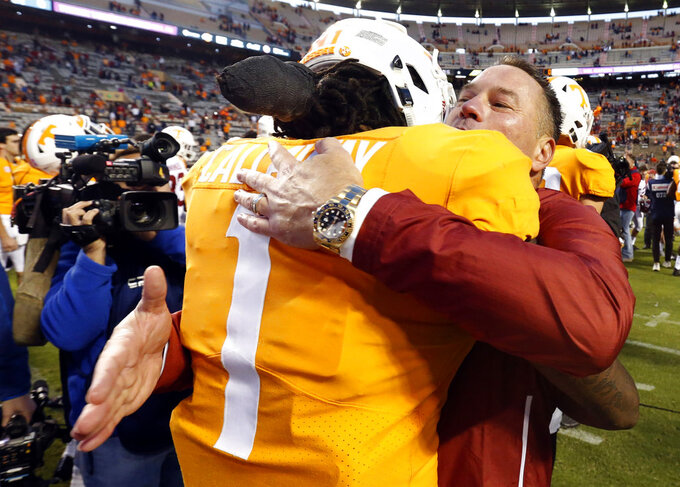Former Tennessee head football coach Butch Jones hugs Tennessee wide receiver Marquez Callaway (1) after an NCAA college football game Saturday, Oct. 20, 2018, in Knoxville, Tenn. Alabama won 58-21. (AP Photo/Wade Payne)