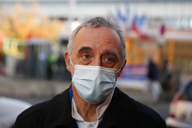 Dr. Philippe Montravers speaks with The Associated Press at the main entrance of the Bichat Hospital, in Paris on Tuesday, Nov. 10, 2020. Montravers and the 150 doctors and nurses he leads have become experts about how to treat COVID-19. That knowledge is proving invaluable against a second deadly surge of the virus is again threatening to overwhelm European health systems. (AP Photo/Francois Mori)