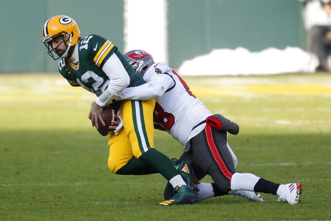 Green Bay Packers quarterback Aaron Rodgers is sacked by Tampa Bay Buccaneers' Shaquil Barrett during the first half of the NFC championship NFL football game in Green Bay, Wis., Sunday, Jan. 24, 2021. (AP Photo/Matt Ludtke)