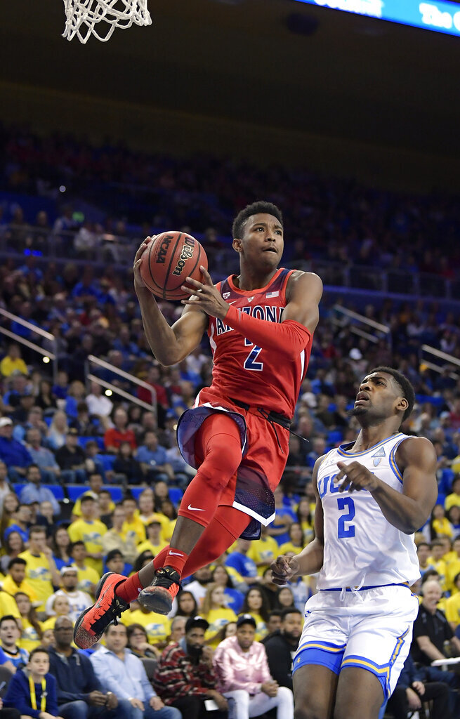 Arizona guard Brandon Williams drives as UCLA forward Cody Riley defends during the first half of an NCAA college basketball game Saturday, Jan. 26, 2019, in Los Angeles. (AP Photo/Mark J. Terrill)