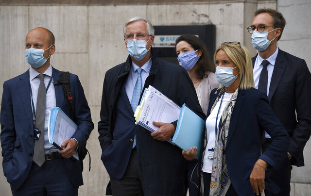 EU Chief negotiator Michel Barnier , second from left, arrives with his team at the Westminster Conference Centre in London, Wednesday, Sept. 9, 2020. UK and EU officials begin the eighth round of Brexit negotiations in London. (AP Photo/Alberto Pezzali)