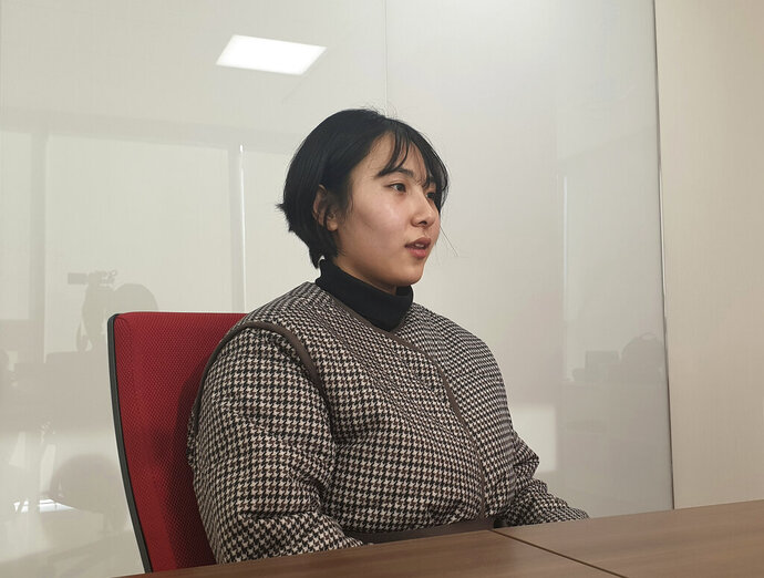 """In this Jan. 16, 2019, photo, Park I Seul speaks during an interview in Seoul, South Korea. As she pursued her dream of becoming a fashion model, Park realized she was neither tall or skinny, like typical runway models, nor """"big enough"""" to be a plus-size model. She also realized one day that the only way to meet the lofty ideals of South Korea's beauty standards was for her to continuously deny herself. Her newfound view of her body is part of a growing movement by South Korean women who have begun to resist what they see as extreme pressure to look a certain way. (AP Photo/Jung Yoon Kim)"""