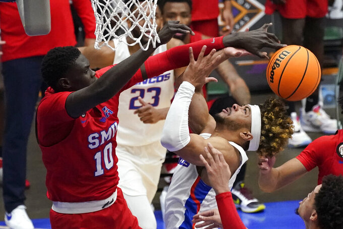 SMU forward Yor Anei (10) blocks a shot by Boise State guard Marcus Shaver Jr. during the first half of an NCAA college basketball game in the first round of the NIT, Thursday, March 18, 2021, in Frisco, Texas. (AP Photo/Tony Gutierrez)