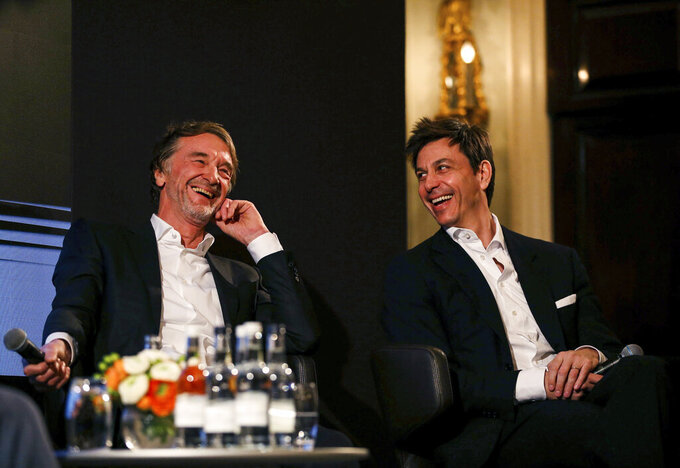 """Toto Wolff, Team Principal & CEO of The Mercedes AMG-PETRONAS F1 Team, right, and INEOS Founder and Chairman Jim Ratcliffe attend a media briefing in London, Monday, Feb. 10, 2020. The Mercedes Formula One team is still waiting to secure a long-term commitment from world champion Lewis Hamilton. Wolff says he hasn't spoken to Hamilton since the Christmas party after agreeing to """"leave each other in peace"""" in the offseason. Mercedes has longer certainty from its new sponsor INEOS, the chemicals giant owned by Jim Ratcliffe. (Steven Paston/PA via AP)"""