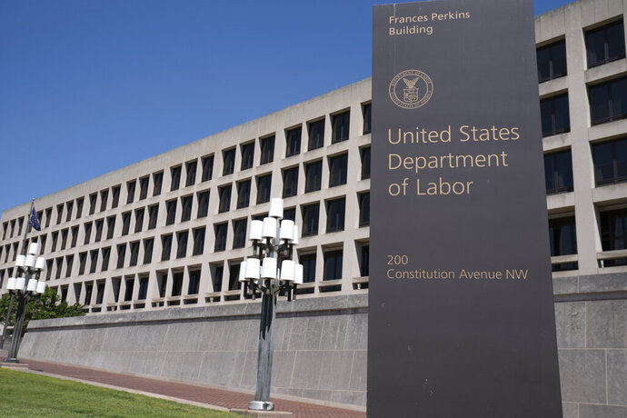 FILE - The entrance to the Labor Department is seen near the Capitol in Washington, Thursday, May 7, 2020.  Civil rights groups on Thursday, Jan. 21, 2021 celebrated President Joe Biden's swift revocation of a Trump administration order that had banned federal agencies, contractors and recipients of federal funding from conducting certain diversity training. The Department of Labor had already suspended enforcement of the order after a California federal court granted a preliminary injunction against it in response to a lawsuit filed by Lambda Legal, an organization that advocates for the rights of LGBT people. (AP Photo/J. Scott Applewhite, file)