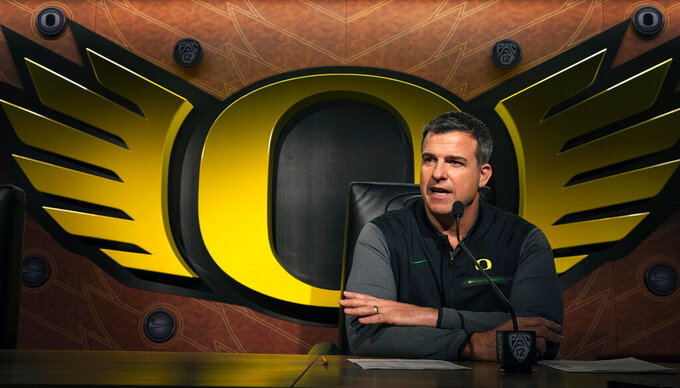 Oregon NCAA college football head coach Mario Cristobal talks to the media on signing day in Eugene, Ore. Wednesday, Feb 6, 2019. (Chris Pietsch/The Register-Guard via AP)