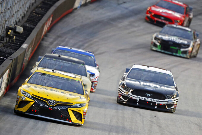 Erik Jones (20) leads the field down the back straight during a NASCAR Cup Series auto race, Saturday, Aug. 17, 2019, in Bristol, Tenn. (AP Photo/Wade Payne)