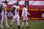 Atlanta Falcons place kicker Younghoe Koo, right, walks off the field after missing a 39-yard field goal during the second half of an NFL football game, Sunday, Dec. 27, 2020, in Kansas City. The Chiefs defeated the Falcons 17-14. (AP Photo/Jeff Roberson)
