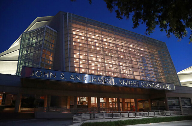 FILE- In this June 21, 2019 file photo, the Knight Concert Hall at the Adrienne Arsht Center for the Performing Arts of Miami-Dade County is lit up before dusk in Miami. The site of Democratic Presidential Debates in June 2019, will host a presidential debate after the University of Michigan withdrew after siting the work needs to prepare the campus for fall during the coronavirus. (AP Photo/Wilfredo Lee, File)