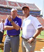 Clemson head coach Dabo Swinney, right, talks with Furman head coach Clay Hendrix before the start of an NCAA college football game Saturday, Sept. 1, 2018, in Clemson, S.C. (AP Photo/Richard Shiro)
