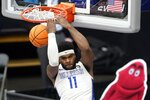 Saint Louis forward Hasahn French performs a reverse dunk on a breakaway play during the second half of an NCAA college basketball game against Mississippi State in the first round of the NIT Tournament, Saturday, March 20, 2021, in Frisco, Texas. (AP Photo/Tony Gutierrez)
