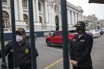 Police stand guard outside Congress in Lima, Peru, Friday, Sept. 18, 2020. Peruvian President Martin Vizcarra's job is on the line Friday as opposition lawmakers push through an impeachment hearing criticized as a hasty and poorly timed ouster attempt in one of the countries hardest hit by the coronavirus pandemic. (AP Photo/Rodrigo Abd)