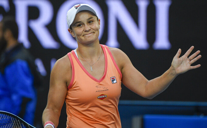 Australia's Ash Barty reacts after defeating Romania's Ana Bogdan in their match during a tuneup tournament ahead of the Australian Open tennis championships in Melbourne, Australia, Tuesday, Feb. 2, 2021. (AP Photo/Andrew Brownbill)