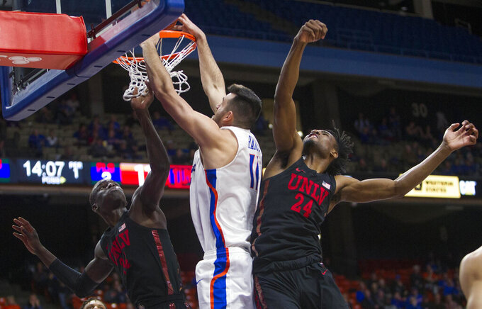 Boise State forward Zach Haney attempts a dunk but is fouled by UNLV forward Joel Ntambwe with UNLV's Cheikh Mbacke Diong also on the play during an NCAA college basketball game Wednesday, Feb. 6, 2019, in Boise, Idaho. (Darin Oswald/Idaho Statesman via AP)