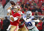 San Francisco 49ers quarterback Jimmy Garoppolo, left, throws a pass in front of Dallas Cowboys defensive end Demarcus Lawrence (90) during the first half of an NFL preseason football game in Santa Clara, Calif., Thursday, Aug. 9, 2018. (AP Photo/Tony Avelar)
