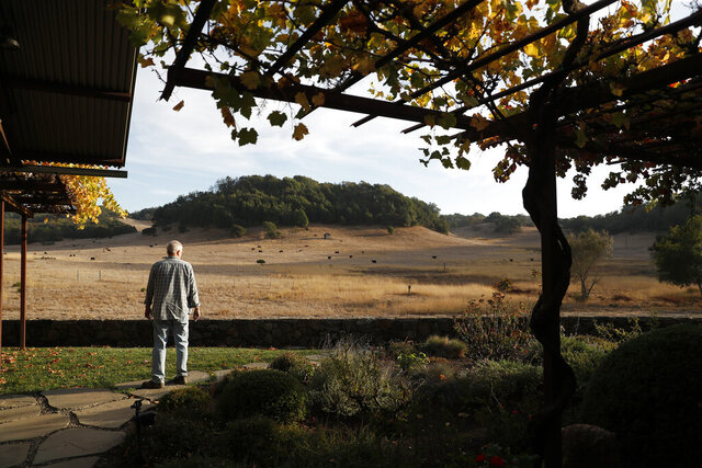 Tom Ruge stands outside the Ranch House at Green Valley Ranch in Napa, Calif., Thursday, Nov. 7, 2019. A 950-acre ranch with three lakes in Napa County that was purchased in 1978 for $850,000 by eight young men and used communally was sold for $15.7 million in cash. Green Valley Ranch was sold Monday, Dec. 7, 2020 to a single unidentified buyer, according to listing agent Ginger Martin of Sotheby's International Realty, the San Francisco Chronicle reported. (Scott Strazzante/San Francisco Chronicle via AP)
