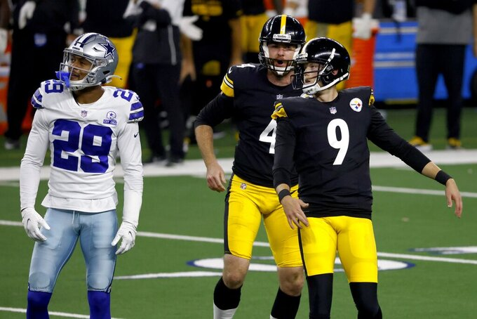 Dallas Cowboys' C.J. Goodwin (29), Pittsburgh Steelers' Jordan Berry (4) and Chris Boswell (9) look on at Boswell's field goal kick in the second half of an NFL football game in Arlington, Texas, Sunday, Nov. 8, 2020. (AP Photo/Ron Jenkins)