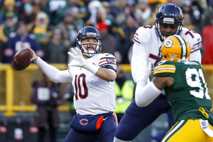 Chicago Bears' Mitchell Trubisky throws during the first half of an NFL football game against the Green Bay Packers Sunday, Dec. 15, 2019, in Green Bay, Wis. (AP Photo/Matt Ludtke)
